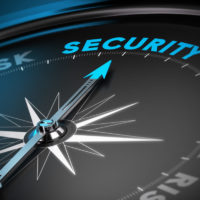 Compass needle pointing the word security. Concept image blue and black tones